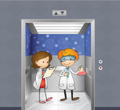 Two doctors inside the elevator Stock Images