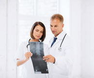 Two doctors looking at x-ray Stock Photography