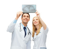 Two doctors looking at x-ray Stock Photos