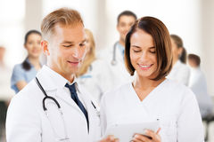 Two doctors looking at tablet pc Royalty Free Stock Photo
