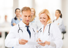Two doctors looking at tablet pc Stock Photos