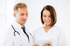 Two doctors looking at tablet pc Royalty Free Stock Image