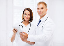 Two doctors looking at tablet pc Stock Photo
