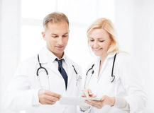 Two doctors looking at tablet pc Stock Images