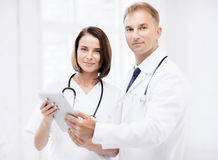 Two doctors looking at tablet pc Royalty Free Stock Photography