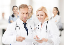 Two doctors looking at tablet pc Stock Image