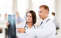 Two doctors looking at x-ray Royalty Free Stock Photo