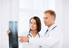 Two doctors looking at x-ray Royalty Free Stock Photography
