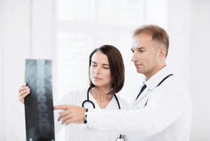 Two doctors looking at x-ray Royalty Free Stock Photos