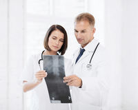 Two doctors looking at x-ray Stock Photo