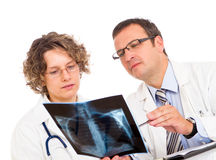 Two doctors looking an x-ray image Royalty Free Stock Image