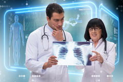 The two doctors looking at x-ray image Stock Images
