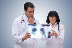 The two doctors looking at x-ray image Stock Photo
