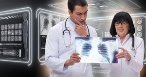 The two doctors looking at x-ray image Royalty Free Stock Photos