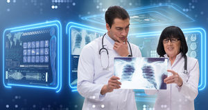 The two doctors looking at x-ray image Royalty Free Stock Photography