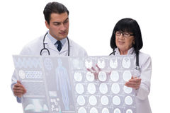 The two doctors looking at x-ray image isolated on white Stock Image