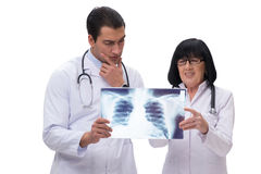 The two doctors looking at x-ray image isolated on white Royalty Free Stock Photos