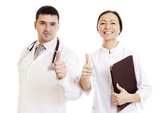 Two doctors male and female showing ok sign. Isolated on white Royalty Free Stock Photos
