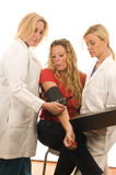 Two doctors  medical clothes patient Stock Images