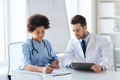 Two doctors meeting at hospital office Royalty Free Stock Photo