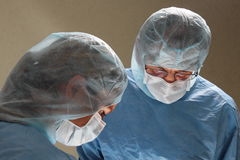 Two doctors during a operation in a hospital OP Royalty Free Stock Photo