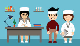 Two doctors and the patient Stock Photo