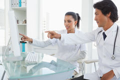 Two doctors pointing to computer screen Stock Image