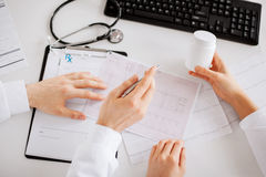 Two doctors prescribing medication Royalty Free Stock Photography
