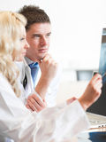 Two doctors with a radiogram. 1 Royalty Free Stock Image