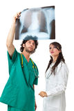 Two doctors and an x ray film royalty free stock image