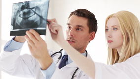 Two doctors with x-ray prints. Closeup of two doctors with x-ray prints stock video footage