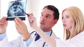 Two doctors with x-ray prints stock video footage