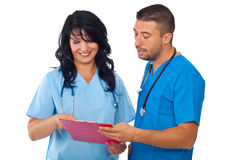 Two doctors reading on clipboard Stock Image