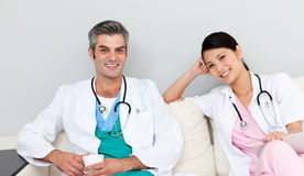 Two doctors relaxing and drinking coffee Stock Photo