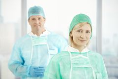 Two doctors in scrubs. Looking at camera, smiling stock image