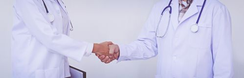Two doctors shake their hands. Medical handshake stock photos