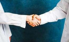 Two doctors shaking hands close up. Team work Stock Images