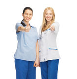 Two doctors showing thumbs up Stock Image