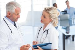 Two doctors speaking Royalty Free Stock Photo