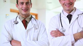 Two doctors standing. In a hospital stock video