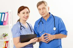 Two doctors standing in medical office clinic, doctor and nurse, medical insurance royalty free stock images