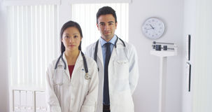 Two doctors standing in office Stock Image