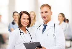 Two doctors with stethoscopes. Healthcare and medical concept - two doctors with stethoscopes Royalty Free Stock Photos