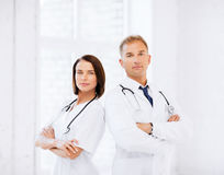 Two doctors with stethoscopes Stock Photos