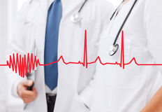 Two doctors with stethoscopes Stock Image