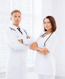 Two doctors with stethoscopes Stock Images