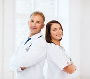 Two doctors with stethoscopes Royalty Free Stock Image