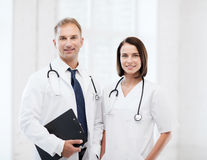 Two doctors with stethoscopes royalty free stock images