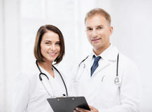 Two doctors with stethoscopes Stock Photography