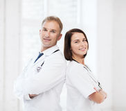 Two doctors with stethoscopes Royalty Free Stock Photography
